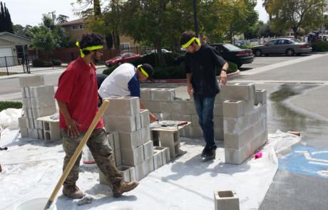 Kids making concrete wall 1