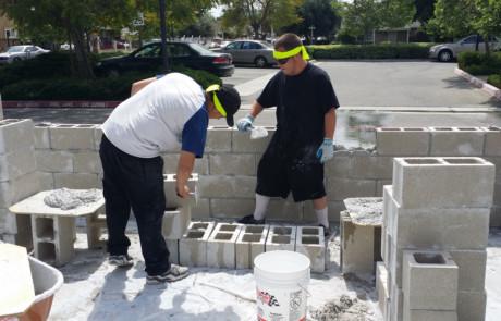 Kids making concrete wall 2