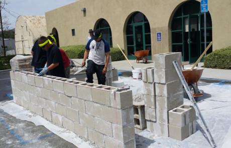 Kids building concrete wall 1
