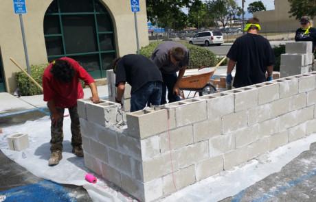 Kids building concrete wall 2